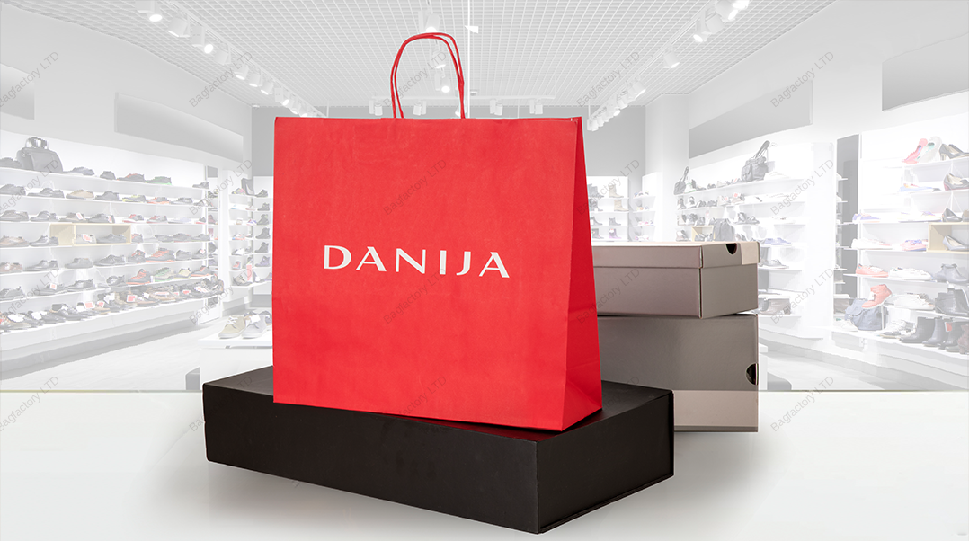 White Twisted Handle Paper Bags in size: 32 cm width x 17 cm depth x 41 cm height produced in Europe.