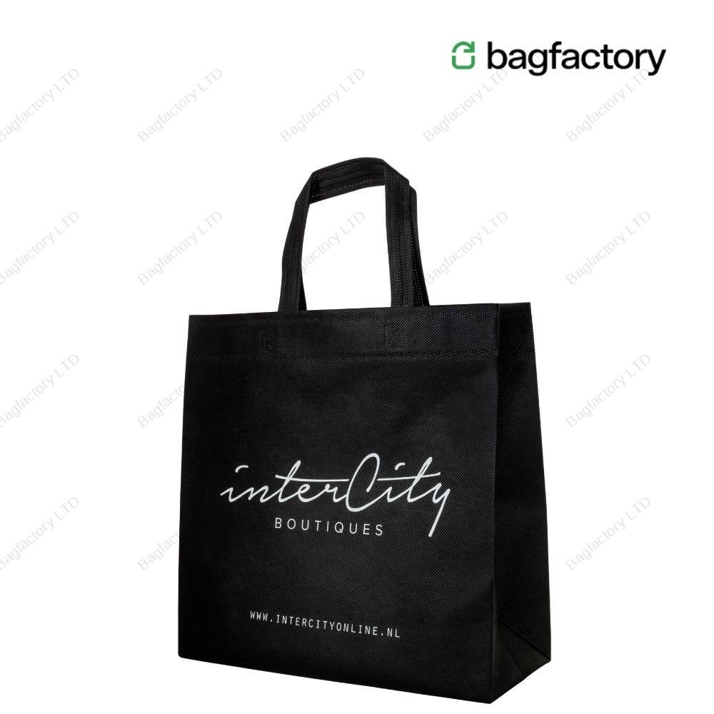 Ekologiczna kwadratowa torba na zakupy z włókniny o wymiarach 36 cm szerokość x14 cm głębokość x 35 cm wysokość z krótkimi uchwytami